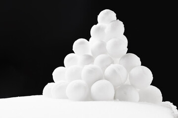 snowballs heap on black background