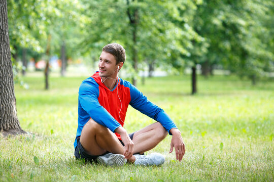 Man having rest after workout outdoor.