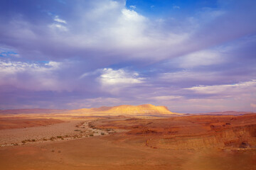 Fototapete - Beautiful desert landscape at sunset light with the dramatic evening sky. Mountain on the horizon