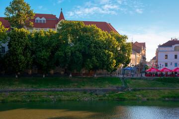 UZHHOROD, UKRAINE - JUN 04, 2017. beautiful sunny morning in uzhgorod. embankment of the river uzh in summertime