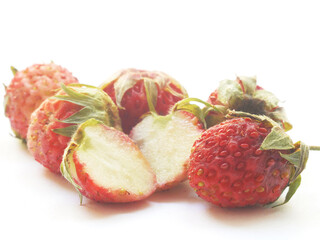 Fototapete - Wild strawberry closeup isolated on a white background.