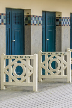 Original beach closet on Promenade des Planches in Deauville. They are dedicated to actors and moviemakers who participated in Film Festival of Deauville. DEAUVILLE, FRANCE. July 18, 2018.
