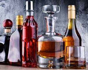 Poster Bar Carafe and bottles of assorted alcoholic beverages.