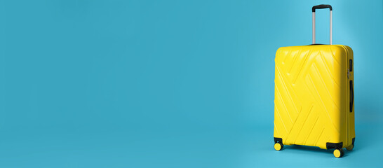 Stylish suitcase on blue background, space for text. Banner design
