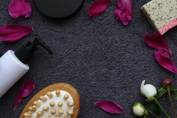 spa home. massage brush, soap and cream on a background of gray towel
