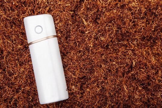 image of electronic smoke device tobacco background