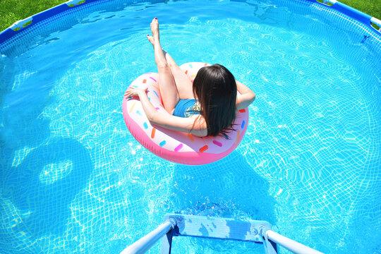Pool time. Girl has fun in a swimming pool.