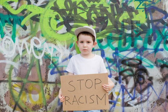 Boy with anti-racist carboard sign