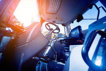 Modern tractor cabin interior. Agricultural exhibition. Industrial