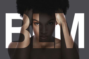 Portrait of young black woman with a lettering BLM