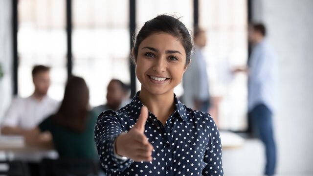 Head shot of friendly indian boss greeting client stretch out hand welcoming express amity good manners meet job vacancy applicant, first acquaintance, human resource HR manager recruiter work concept