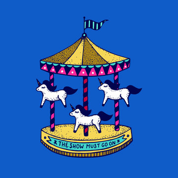 Multi-colored carousel with unicorns. The show must go on