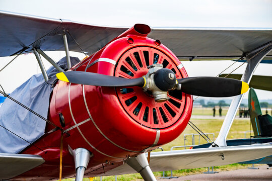 Fragment propeller with engine and retro airplane close up. Screw plane