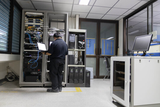 The network system administrator  works in the server room of the data center.