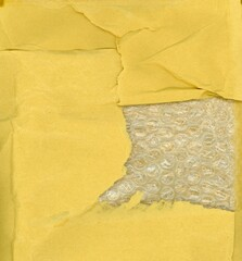 yellow paper and bubble wrap texture background