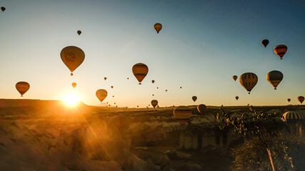 Foto op Plexiglas Ballon hot air balloons at sunrise