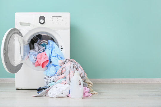 Washing machine with dirty clothes and detergent in home laundry room