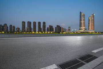 Fotomurales - Empty asphalt road through modern city in nanjing, China