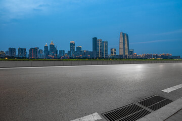 Fotomurales - urban traffic road with cityscape in background, China.