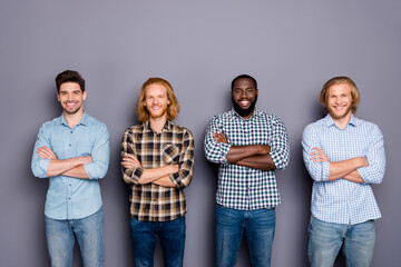 Portrait of four nice attractive content cheerful cheery virile guys best buddy fellow coworkers...