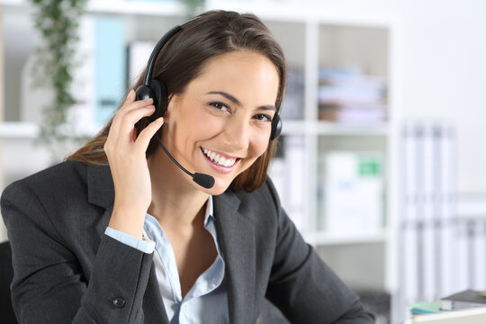 Happy telemarketer posing looking camera at office