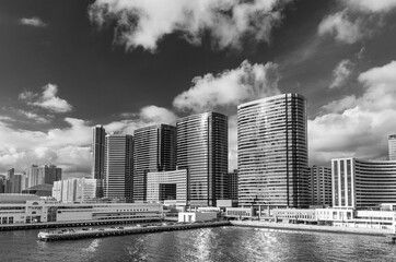 Fototapete - Pier and modern office building in downtown of Hong Kong city