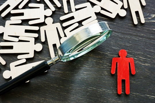 Human resource management and talent choice. Magnifying glass and figures of employees.