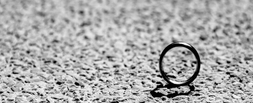 Close-up Of Wedding Ring On Beach