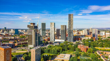 Aerial shot of Manchester UK on a beautiful summer day during pandemic lock-down with tall building in the foreground