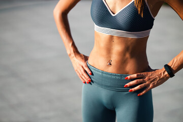 Fit woman with flat stomach and strong muscles