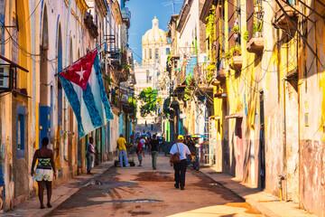 Fotobehang Havana People In Alley Amidst Buildings During Sunny Day