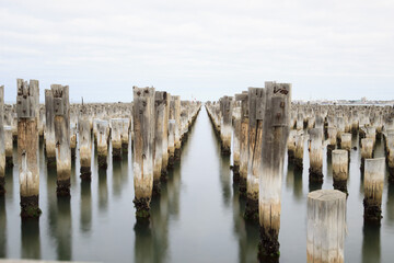 Panoramic View Of Wooden Posts Of Old Princes Pier In Sea Against Overcast Sky