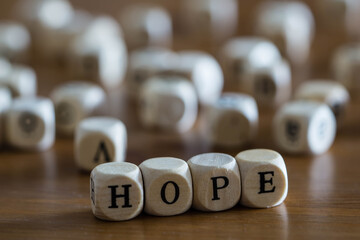 Hope written with woodeb cubes