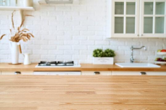 Kitchen wooden table top and kitchen blur background interior style scandinavian