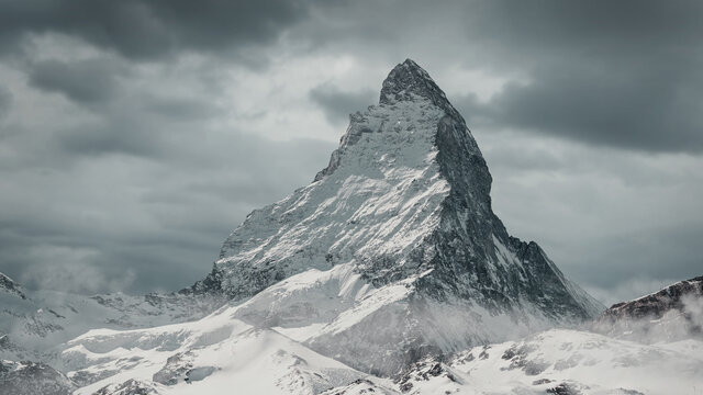 view to the majestic Matterhorn mountain in front of cloudy sky