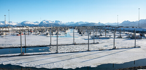 Mostly iced over small boat harbor in Homer Alaska