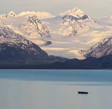 Grewingk Glacier glows with the pink of sunset on the shores of Kachemak Bay