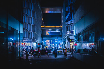 Estores personalizados com sua foto People On Illuminated Street Amidst Buildings In City At Night