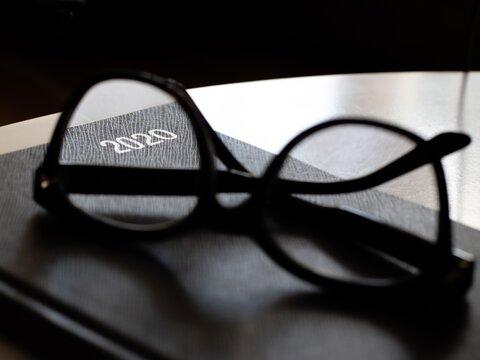 Reading glasses on black 2020 diary