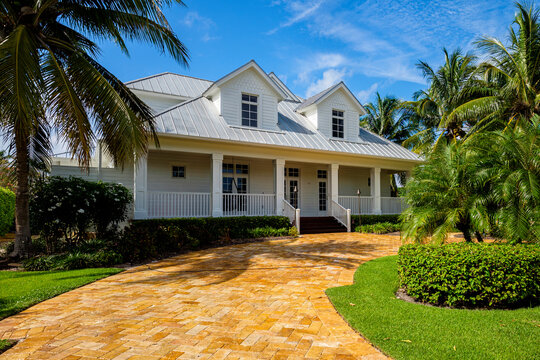 Beautiful wood frame architecture style home with new aluminum style roof in the coastal residential historic district of Naples.