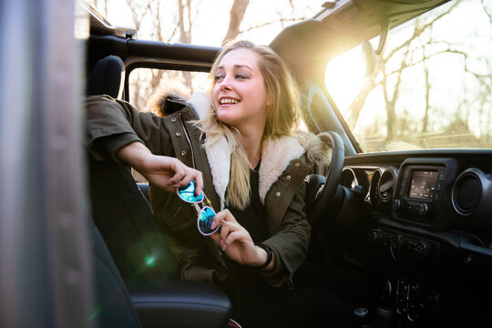 Beautiful woman driver on a road trip holiday in nature, outdoors camping adventure lifestyle getaway, recreational vacation