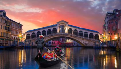 Romantic gondola ride near Rialto Bridge - Venice, Italy