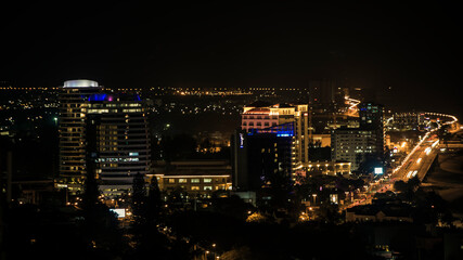 Fotomurales - High Angle View Of Illuminated Buildings In City At Night