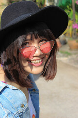 Portrait Of Smiling Young Woman Wearing Sunglasses And Hat