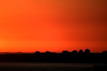 Foto auf Acrylglas Rot Scenic View Of Silhouette Landscape Against Orange Sky