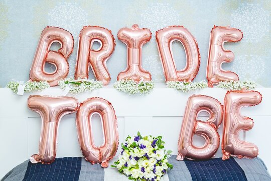 Bride to be balloon letters sign on the bed - bridal shower concept