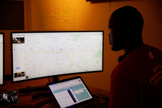 A dispatcher for the Rescue.co free ambulance service looks at a computer screen during the coronavirus night curfew in Nairobi
