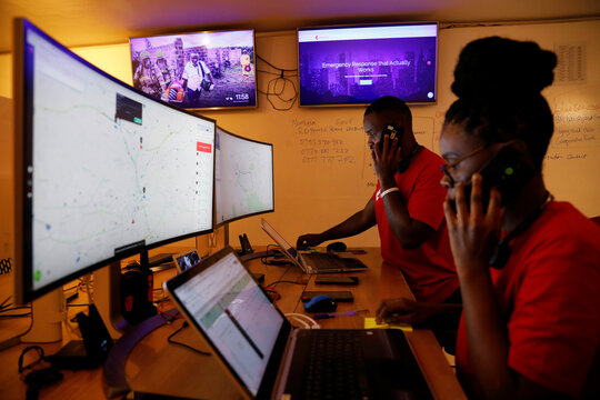 Dispatchers for the Rescue.co free ambulance service look at computer screens during the coronavirus night curfew in Nairobi