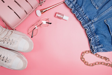 Fashion accessories on pink background.