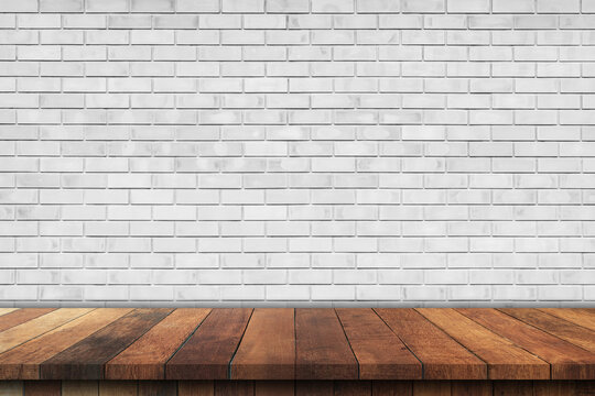 Empty wood table over white brick wall background, product montage display background